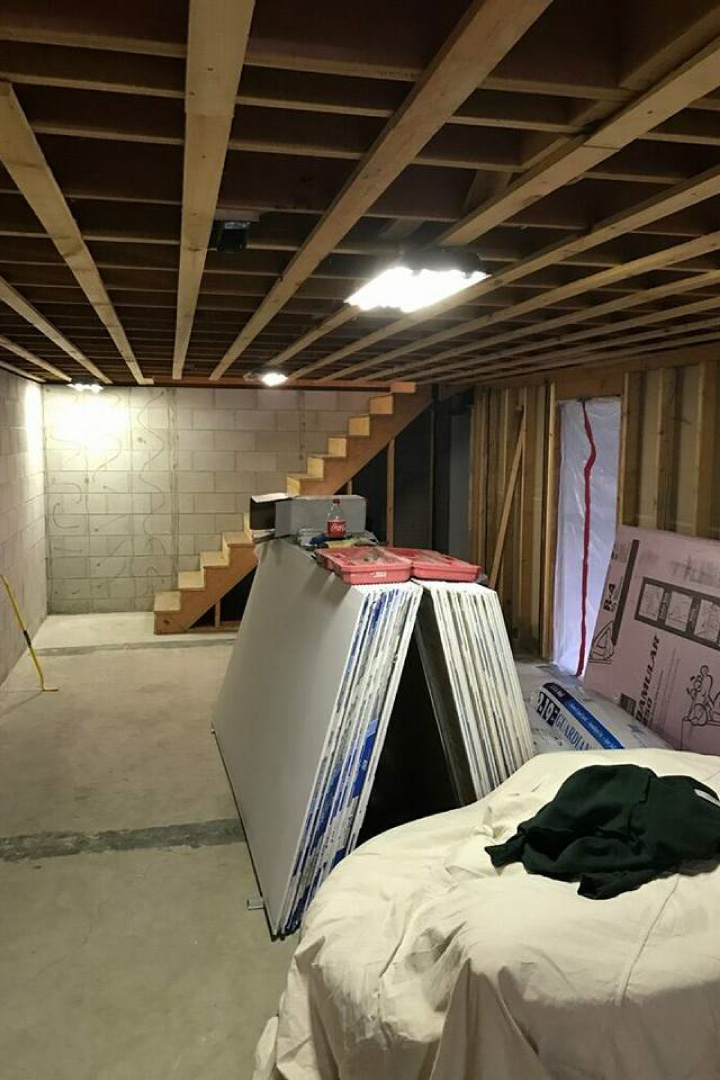 Unfinished basement with exposed ceiling & cement floor